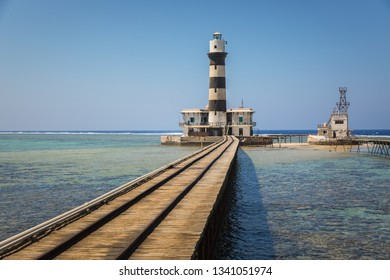 Long pier with lighthouse at the end