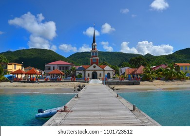 Long pier of the little town of Les Anses-d'Arlet, Martinique. Vibrant and magnificent Caribbean colors. French overseas department, French Antilles aka French West Indies