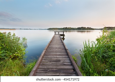 long pier on lake and blue sky in summer