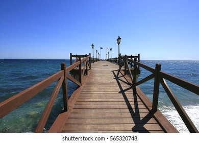 Long pier on the sea in Marbella, Costa del Sol, Spain