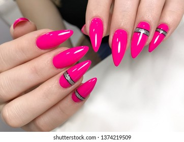 Long pink refill nails with silver stripes