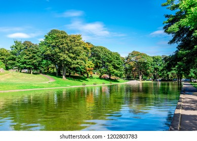 A long pond and an alley in Duthie park near the entrance, Aberdeen, Scotland