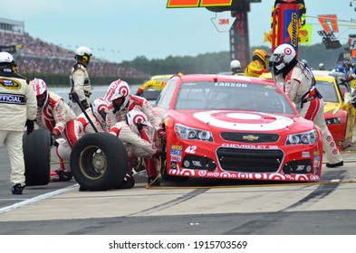 Long Pond, PA, USA - August 3, 2014:  NASCAR driver Kyle Larson makes a pit stop during the 2014 NASCAR Go Bowling.com 400 at Pocono Raceway in Pennsylvania.