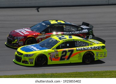 Long Pond, PA, USA - August 4, 2013:  NASCAR drivers Paul Menard (27) and Jeff Gordon race each other during the 2013 NASCAR Go Bowling.com 400 at Pocono Raceway in Pennsylvania.