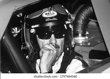 Long Pond, PA / USA - June 18, 1989: A vintage, grainy black and white photo of legendary NASCAR stock car driver Richard Petty in his car at Pocono International Raceway.