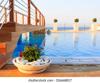 Long pool with salt water below wooden bridge