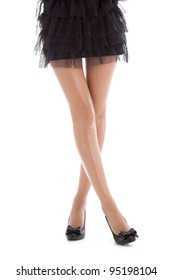 Long pretty woman legs, isolated on white background, sexy female legs in shoes on a heel, in short black dress posing, series photo