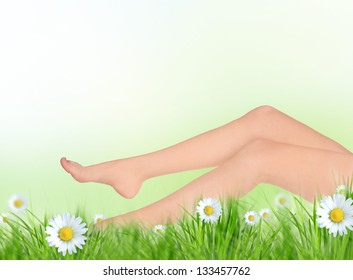 Long pretty woman legs on spring meadow