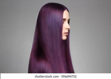 Long purple coloring Hair Beautiful young woman. Hair care. fashion beauty girl