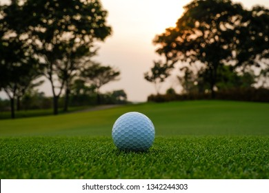 A long putt on green as sunset closes in