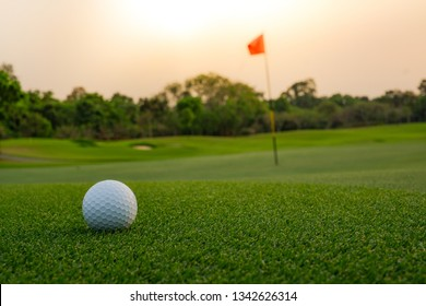 A long putt on the  green as sunset closes in