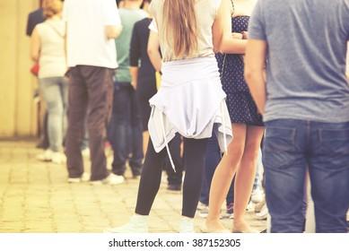 Long queue of people, vintage effect