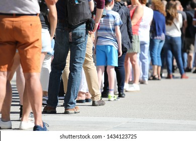 Long queue of people waiting in line