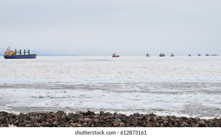 Long queue of ships on the Baltic sea in winter