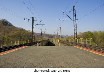 long railway platform on forest background