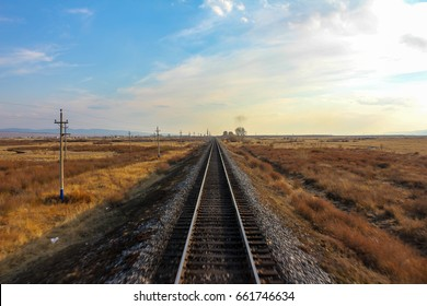 Long railway view at sunset, Trans Siberian railway