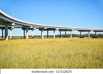 Long raised concrete bridge crossing marsh
