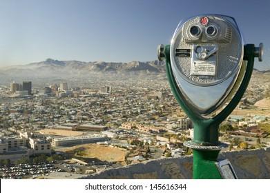 Long range binoculars and downtown of El Paso in Texas looking toward Juarez, Mexico