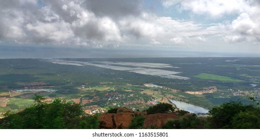 """Long range view of salt fields and the neighboring Indian ocean - Kanyakumari, Tamil nadu"""