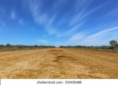 Long red dusty road in the Australian outback