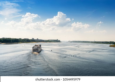 The long river, the next river, the city of Rybinsk. View of the White boat on the Volga River. Blue sky white clouds