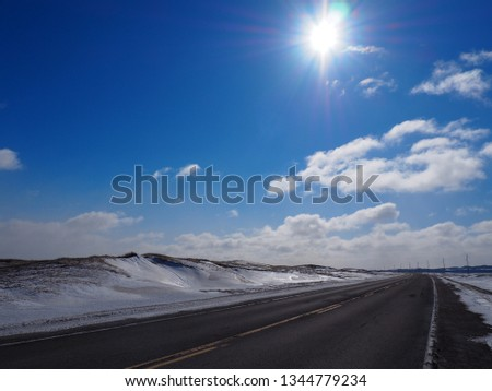 ce7d08abe011e Long road 199 to Havre Aubert in winter, hot sun and clear blue sky,  Magdalen islands, Quebec, Canada - Image