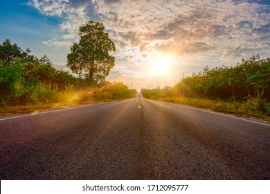 Long road street for transportation on sunset background, high way road and sunshine between forest on hills, blue sky background beauty, same as travel of life is long life, journey photo landscape