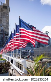 Long Row of American Flags Fly in the Wind