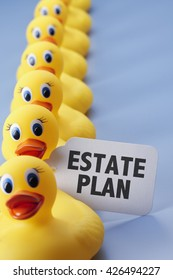 A long row of yellow rubber ducks with a sign that says Estate Plan on it.