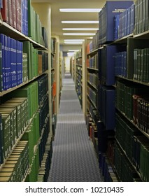 Long rows of full of books in large public library in northern California.