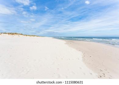 The long sand beach of Sandhammaren, Skane Sweden in morning view