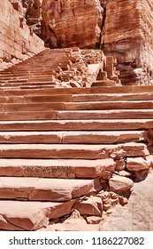 A long series of red sandstone steps leads to the Urn Tomb in the Royal Tombs area of Petra in Jordan.