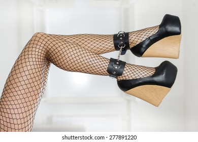 ba756974e4f7 Long and sexy legs wearing fishnet stockings and extreme platform shoes in black  patent leather and