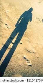 long shadow on sand