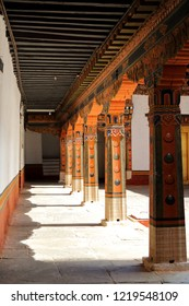 long shadows cast by the afternoon sun on one of the corridors in Punakha Dzong, Punakha, Bhutan.