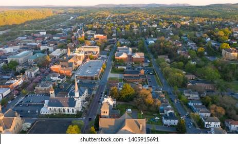 Long shadows light up the buildings in the hilltop village of Lynchburg Virgina