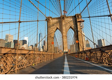 Long Shadows on Deserted Pedestrian Walkway Through Iconic Arches of Historic Brooklyn Bridge at Sunset, New York City, New York, USA