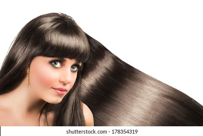 Long shiny hair of a beautiful brunette woman