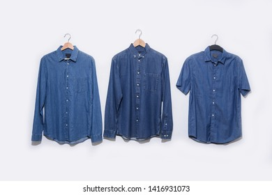 long and shorts sleeve blue shirt on hanging and jeans shirt. Elegant blue shirt for man isolated on white background