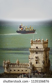 Long shot of Belem tower with large cargo ship