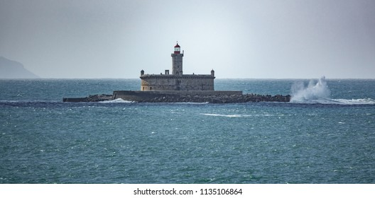 Long shot of Fort in the ocean near Lisbon with waves breaking