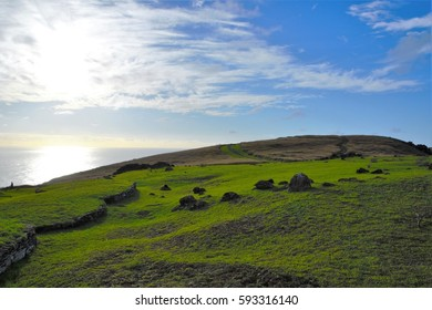 Long shot of the Orongo village between the Rano Kau crater and the Pacific ocean close to Hanga Roa the capital of Easter Island, Rapa Nui, Chile, South America