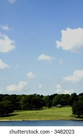 Long shot of people in the park on a sunny day, Roundhay park, Leeds, UK