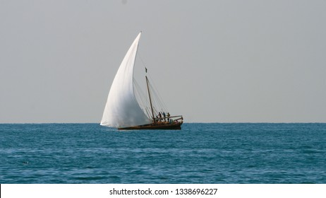 Long shot of sailing yacht with big white sails in the open sea