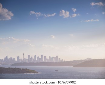A long shot of the Sydney skyline under a blue sky taken from the North Head cliffs at Manly, New South Wales, Australia