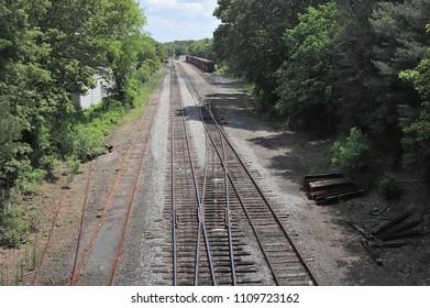 A long shot of a train yard, Walpole, MA.