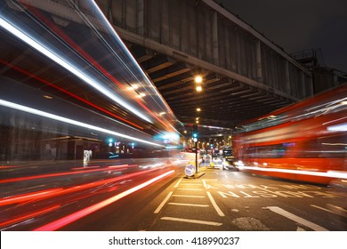 Long shutter near to the London Bridge Station. Busy traffic under the railway bridge at night.