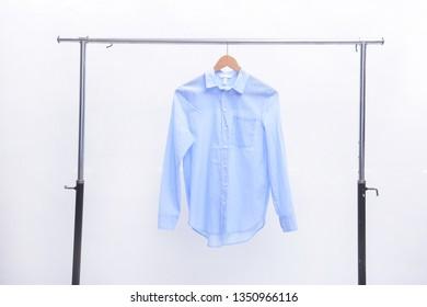 long sleeve blue shirt on hanger