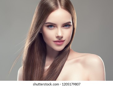 Long smooth hair healthy and beautiful woman with healthy skin cosmetic shampoo concept female model portrait