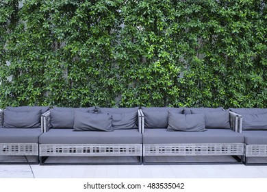 long sofa with natural  green wall background
